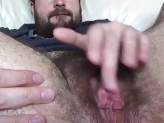 Bearded shemale loves to play around with his vagina