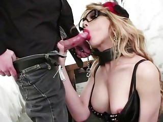 Trans chick on a leash sucks on a dudes dong