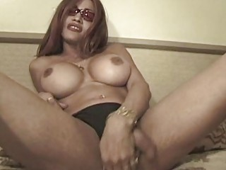 T-girl shows off her big tits before shes sucked off