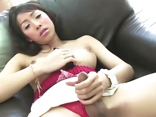 Thai Shemale Dew Toys Ass And Masturbates