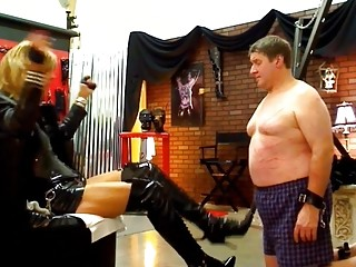 Fat slave boy licks the shoes of his shemale mistress