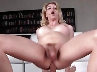 Voluptuous blonde shemale gets his prick deep down her throat