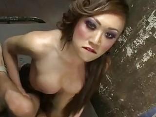 Asian tranny in stockings fucks her man mercilessly