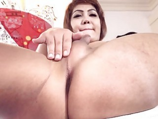 Short-haired Asian strokes her little cock like a shemale should