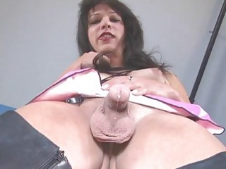 Randy Tgirl in leather boots strokes her cock to cumshot