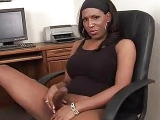 Busty ebony tranny strips and teases for her sugar daddy.