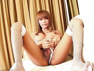 Asian tranny strips and masturbates like a pro